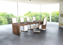 Curl_scene_extending_dining_table_leather_chairs_tom_schneider_curved_furniture